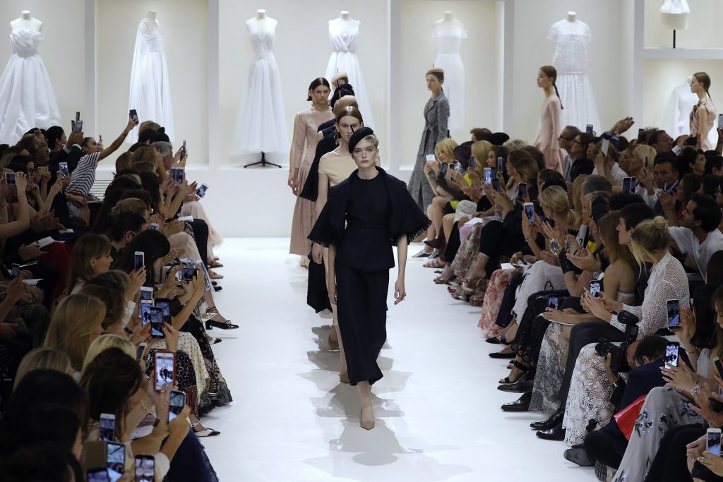 Models present creations by Christian Dior at the end of the 2018-2019 Fall/Winter Haute Couture collection fashion show in Paris, on July 2, 2018. / AFP PHOTO / FRANCOIS GUILLOT